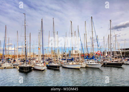 Port of Barcelona, Spain. Yachts, sailing boats - Stock Image
