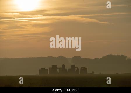 Hazy Sunrise at Stonehenge, UK - Stock Image