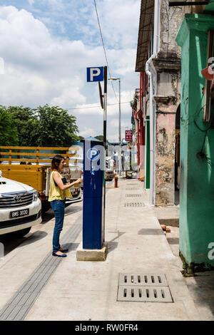 Motorist Paying for Parking, Kuala Lumpur, Malaysia. - Stock Image