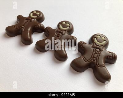 Creative food concept. Chocolate gingerbread men, a Christmas treat - Stock Image