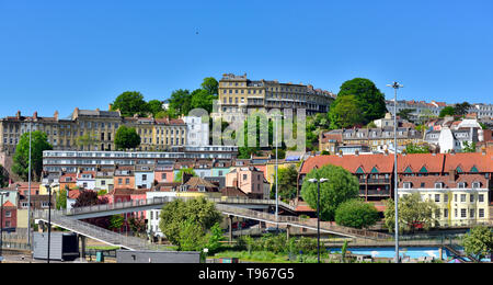 Bristol crescents and terraces of houses in Clifton on hill above Hotwells and city docks - Stock Image