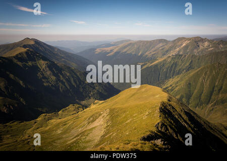 Mountains with skyline and blue sky with little white clouds - Stock Image