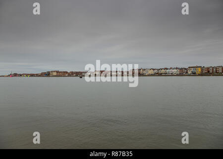 Marine Lake at West Kirby on a grey cloudy day - Stock Image