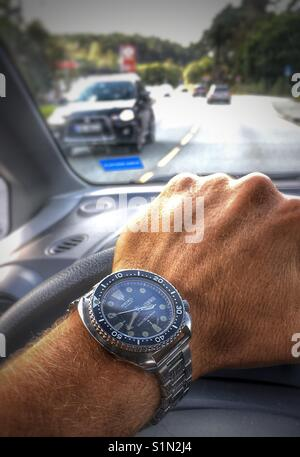Man driving a car - Stock Image