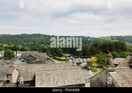 Rooftops of the village of Hawkshead in Cumbria, looking west from the mount of St. Michael and All Angels church. - Stock Image