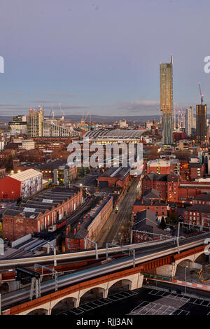 Manchester city centre skyline view across the rooftops from Salford  Beetham Tower, Liverpool Road, and MOSI Museum of Science and Industry site - Stock Image