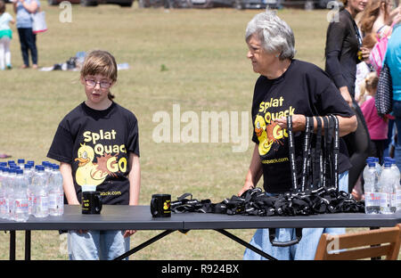 A senior and a teen at a medal table - Stock Image