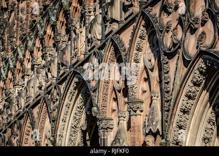 The front of Lichfield Cathedral is covered in ornate carvings. - Stock Image