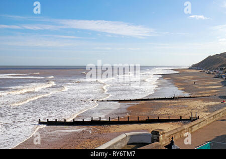 A view eastwards along the beach at the North Norfolk seaside resort of Cromer, Norfolk, England, United Kingdom, Europe. - Stock Image