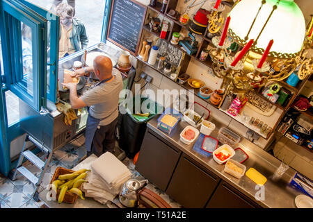 Man making Crepes for tourists in his Creperie, Marais, Paris, France - Stock Image
