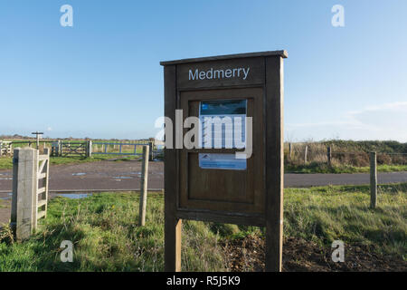 RSPB Medmerry Nature Reserve by the coast at Medmerry, West Sussex, UK. Sign information board at Earnley car park. - Stock Image