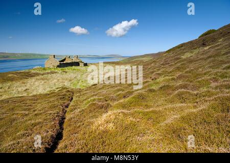Island of Rousay, Orkney, Scotland. Derelict ruined croft house hill farm near Westness. West over Eynhallow Sound. - Stock Image