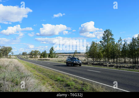 Car motoring on the Carnarvon Highway, South West Queensland, QLD, Australia - Stock Image