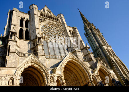 North entrance and the 16th-century Flamboyant spire of Chartres Cathedral, France - Stock Image