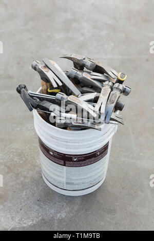 Hammers in bucket - Stock Image
