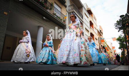 Young girls in traditional Spanish Dress in the Fallas Procession in Gandia Spain - Stock Image