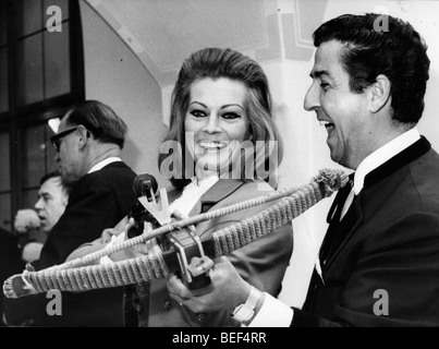 Swedish actress Anita Ekberg holds a crossbow. - Stock Image