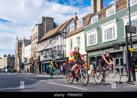 Cambridge, UK -  September 2018. People cycling on the road in Bridge street, Central Cambridge on a summer sunny day. - Stock Image