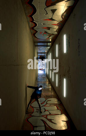 man,graffiti,underpass - Stock Image