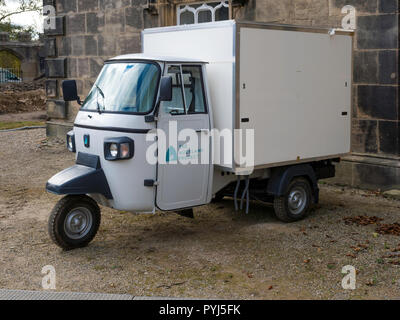 A white 3-wheeled Piaggio van at Auckland Castle used by the Aucland Project personnel - Stock Image