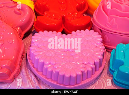 colorful silicon cake molds - Stock Image