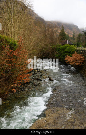 Church Beck river flowing through Coniston, Lake District, Cumbria, England - Stock Image