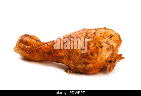 Chicken's leg in sauce on the white isolated background - Stock Image