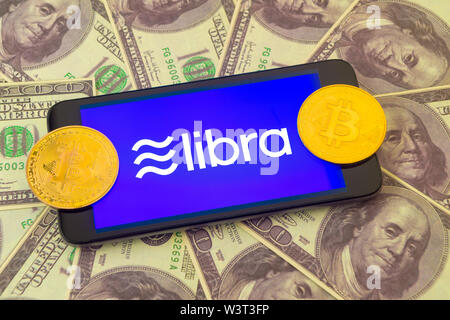 Tula, Russia - 4 July 2019 : Libra coin blockchain concept with smartphone against the background of hundred dollar bills. New project libra a cryptoc - Stock Image