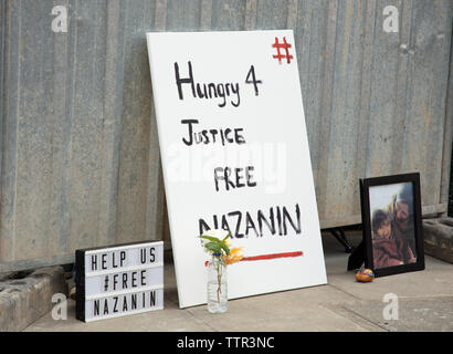 London, UK. 17th June 2019.Family photo and supporting words for Richard Ratcliffe who is on hunger strike in front of the Iranian embassy in London in protest of the detention of his wife Nazanin Zgahari in Iran over spying allegations. Credit: Joe Kuis / Alamy - Stock Image