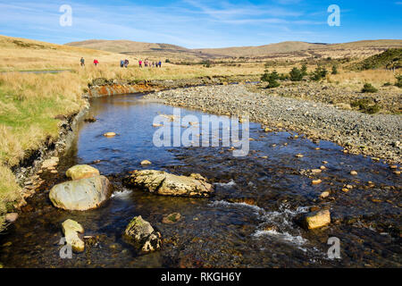 Afon Gain River and walkers in southern Snowdonia National Park. Bronaber, Trawsfynydd, Gwynedd, Wales, UK, Britain - Stock Image