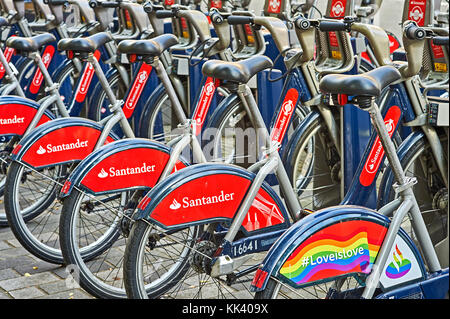 Santander bicycles for hire at a docking station in central London - Stock Image