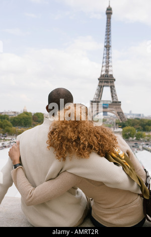 Rear view of African couple hugging - Stock Image
