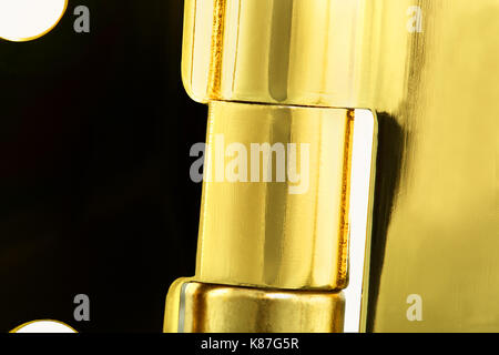 A 'guess what it is', close up image of a door hinge; or close up for use as a background - Stock Image