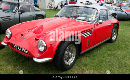 Three-quarter front view of a red, 1969, TVR Tuscan V8 Coupe, on display in the ca 2017 Silverstone Classicr club zone of the 2017 Silverstone Classic - Stock Image