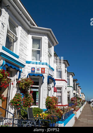 Street of colourful floral decked Guest Houses near the seafront, in Great Yarmouth, Norfolk, England, UK - Stock Image