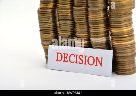 Word decision with coins isolated on white background - Stock Image