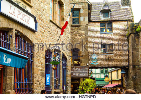 Views & sites around the town and Island of Mont St Michel on a cloudy & wet day in Normandy, France. Post - Stock Image