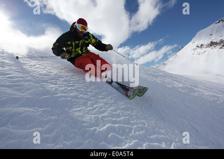 Mid adult man skiing at speed downhill, Mayrhofen, Tyrol, Austria - Stock Image