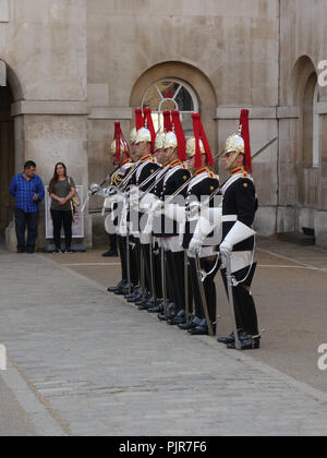 The Quens lifeguards (Blues and Royals) take part in the dismounting ceremony at  Horse Guards Parade, London - Stock Image