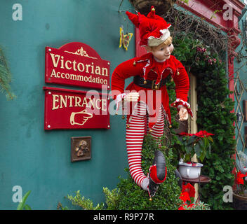 Christmas elf decoration on guest house entrance. - Stock Image