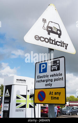 Ecotricity sign at an electric car / vehicle charging point at a service station in the UK - Stock Image