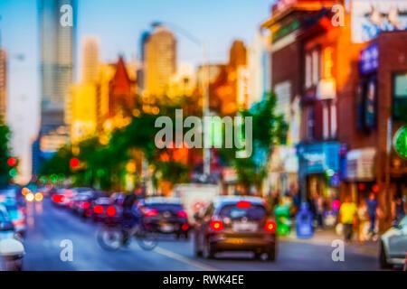 Blurred scene of Bloor Street in Toronto; Toronto, Ontario, Canada - Stock Image