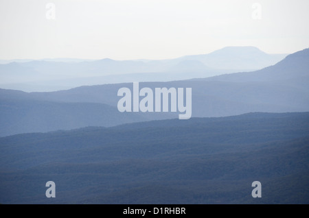 KATOOMBA, Australia - Lines of mountain ridges disappear into the distance in the Blue Mountains as seen from Echo - Stock Image