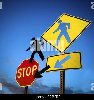 Beware of pedestrian conceptual.  Pedestrian and arrow hole. - Stock Image