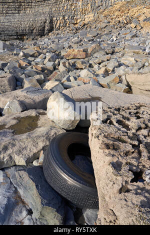 Tyre washed up on the beach at Monknash on the Glamorgan Heritage Coast, South Wales - Stock Image