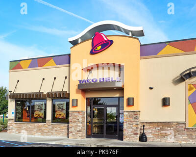 Exterior front entrance to fast food restaurant Taco Bell showing the corporate logo and current design in Montgomery, Alabama USA. - Stock Image