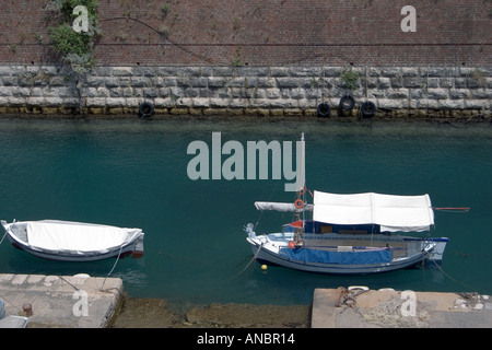 Boats, Contras Fossa moat, Corfu town,  Kerkyra, Greece, boat wooden typical moored mooring pontoon Contras Fossa moat cut canal - Stock Image