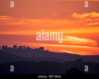 Ashbourne, Derbyshire. 5th Jun, 2018. UK Weather: spectacular sunset over the ancient woods Hazleton Clump Cairn near Thorpe taken from Ashbourne Derbyshire, Peak District National Park Credit: Doug Blane/Alamy Live News - Stock Image