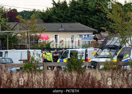Iver, United Kingdom. 11 September 2018. Thames Valley Police has made three arrests following modern slavery warrants carried out in South Buckinghamshire. The arrests were made in connection with warrants carried out at a residential property in Love Lane, lver, South Buckinghamshire. Eight people, believed to be victims of modern slavery, were also safeguarded by the force. Approximately 100 officers were involved in the operation which took place following allegations made about forced labour being carried out at building sites. Credit: Peter Manning / Alamy Live News - Stock Image
