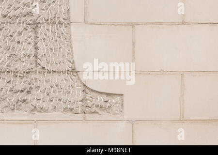 Chiselled / chased limestone facade texture. - Stock Image
